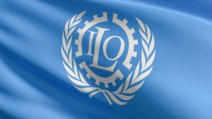 Flag of The International Labour Organization or ILO. United Nations agency whose mandate is to advance social justice and promote decent work by setting international labour standards. 3D render.